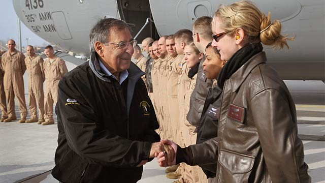 PHOTO: Leon Panetta and female Marine Corps pilot
