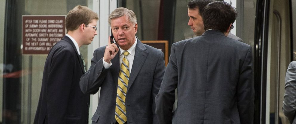 PHOTO: Sen. Lindsey Graham talks on his cell phone as he arrives in the Capitol for the Senate Republicans policy lunch in Washington, D.C., March 12, 2013.
