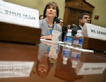 IRS official Lois Lerner pauses during a House Oversight and Government Reform Committee hearing on Capitol Hill in Washington, May 22, 2013, to investigate the extra scrutiny the IRS gave to Tea Party and other conservative groups that applied for tax-exempt status.
