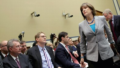 IRS Director of Exempt Organizations Lois Lerner leaves a hearing of the House Oversight and Government Reform Committee, May 22, 2013, in Washington.