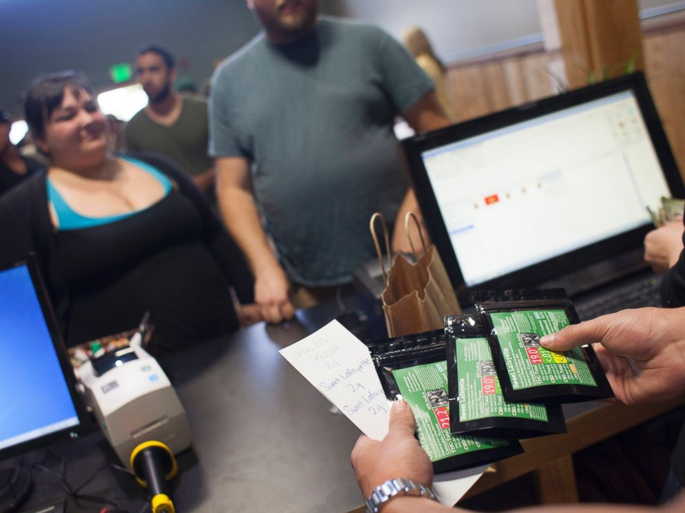 PHOTO: Customers purchase marijuana at Top Shelf Cannabis, a retail marijuana store, on July 8, 2014 in Bellingham, Washington.