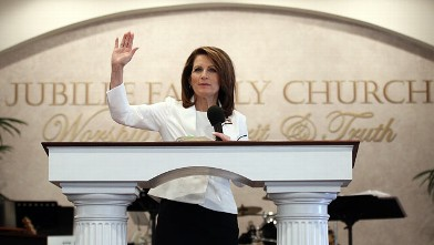 PHOTO: Republican presidential candidate Rep. Michele Bachmann gives her personal testimony while attending services at the Jubilee Family Church,Oskaloosa, Iowa, Jan. 1, 2012.