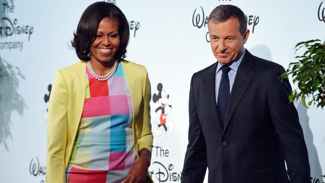 PHOTO: US First Lady Michelle Obama, with Walt Disney Company Chairman and CEO Robert Iger, after speaking at a press conference to announce changes to Disney's nutrition guideline policy on June 5, 2012 at the Newseum in Washington.
