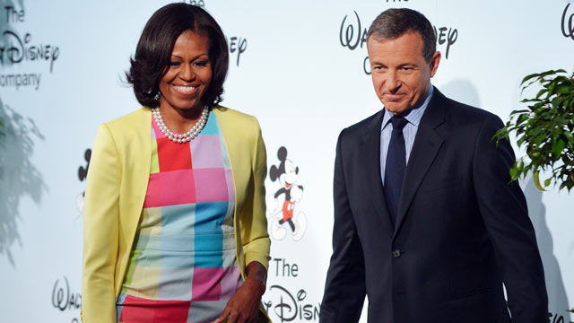PHOTO: US First Lady Michelle Obama, with Walt Disney Company Chairman and CEO Robert Iger, after speaking at a press conference to announce changes to Disneys nutrition guideline policy on June 5, 2012 at the Newseum in Washington.