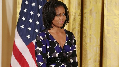 PHOTO: First lady Michelle Obama stands on stage during an awards ceremony for the President's Committee on the Arts and the Humanities in the East Room at the White House on November 19, 2012 in Washington, DC.