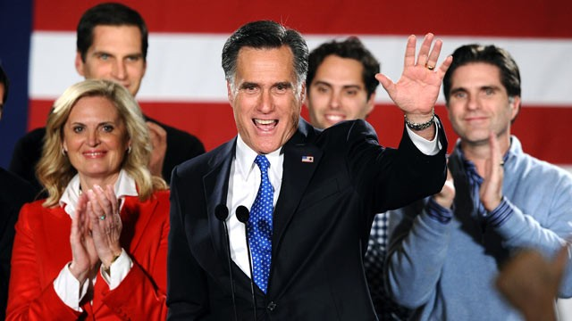 PHOTO: Republican presidential hopeful Mitt Romney waves to his supporters during his caucus night rally following republican caucuses in Des Moines, Iowa, Jan. 3, 2012.