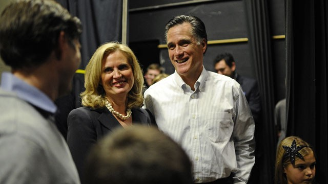 PHOTO: Republican presidential hopeful Mitt Romney shares a moment with his wife Ann and family prior to get on stage to address a rally at McKelvie Intermediate School in Bedford, New Hampshire, Jan. 9, 2012.