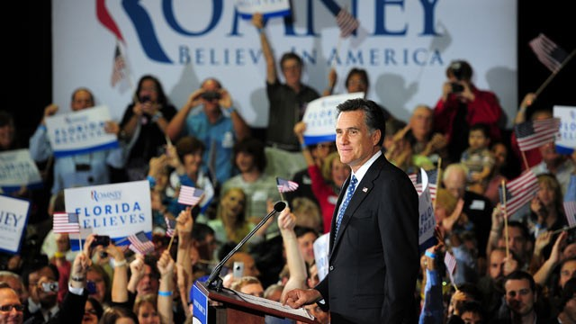PHOTO: Republican presidential hopeful Mitt Romney addresses a primary election night event in Tampa, Florida, January 31, 2012 after  trouncing main rival Newt Gingrich in Florida's Republican primary.