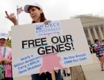 PHOTO: Lisa Schlager of Chevy Chase, demonstrates outside of the Supreme Court as arguments were made in a case seeking to determine whether human genes can be patented. The Supreme Court ruled that genes could not be patented.