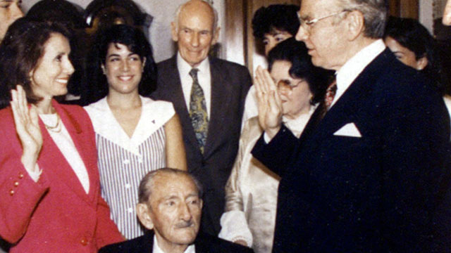 PHOTO: Jim Wright administers the oath of office to Nancy Pelosi, June 9, 1978 as her father, Thomas D'Alesandro Jr., in wheelchair, and others look on.