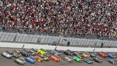 PHOTO: Carl Edwards driver of the #99 Scott's/ Kellogg's Ford leads a pack of cars down the front stretch during the NASCAR Sprint Cup Series Kobalt Tools 400 at Las Vegas Motor Speedway, March 6, 2011 in Las Vegas, Nevada.