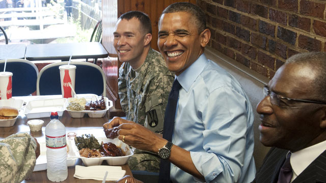 PHOTO: US President Barack Obama eats lunch with two soldiers and two local barbers, in honor of the upcoming Father's Day weekend, at Kenny's BBQ Smokehouse in Washington, DC, June 13, 2012.