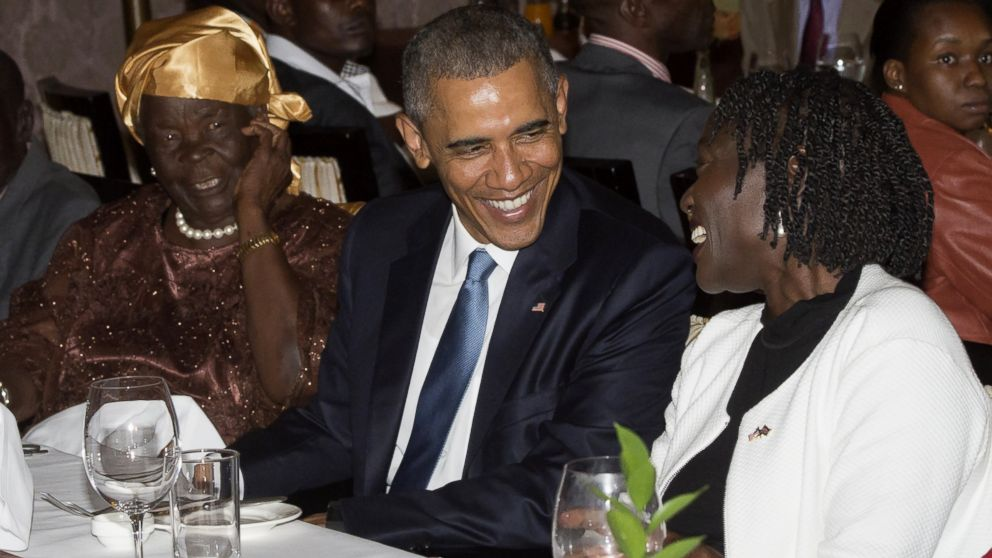 PHOTO: US President Barack Obama sits alongside his step-grandmother, Mama Sarah (L) and half-sister Auma Obama (R), during a gathering of family at his hotel in Nairobi, Kenya, July 24, 2015.