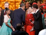 "PHOTO: President Barack Obama shakes hands with South Korean musician PSY, center, with Conan OBrien and performer Scotty McCreery, during the ""Christmas in Washington"" concert at the National Building Museum on Dec. 9, 2012, in Washington."