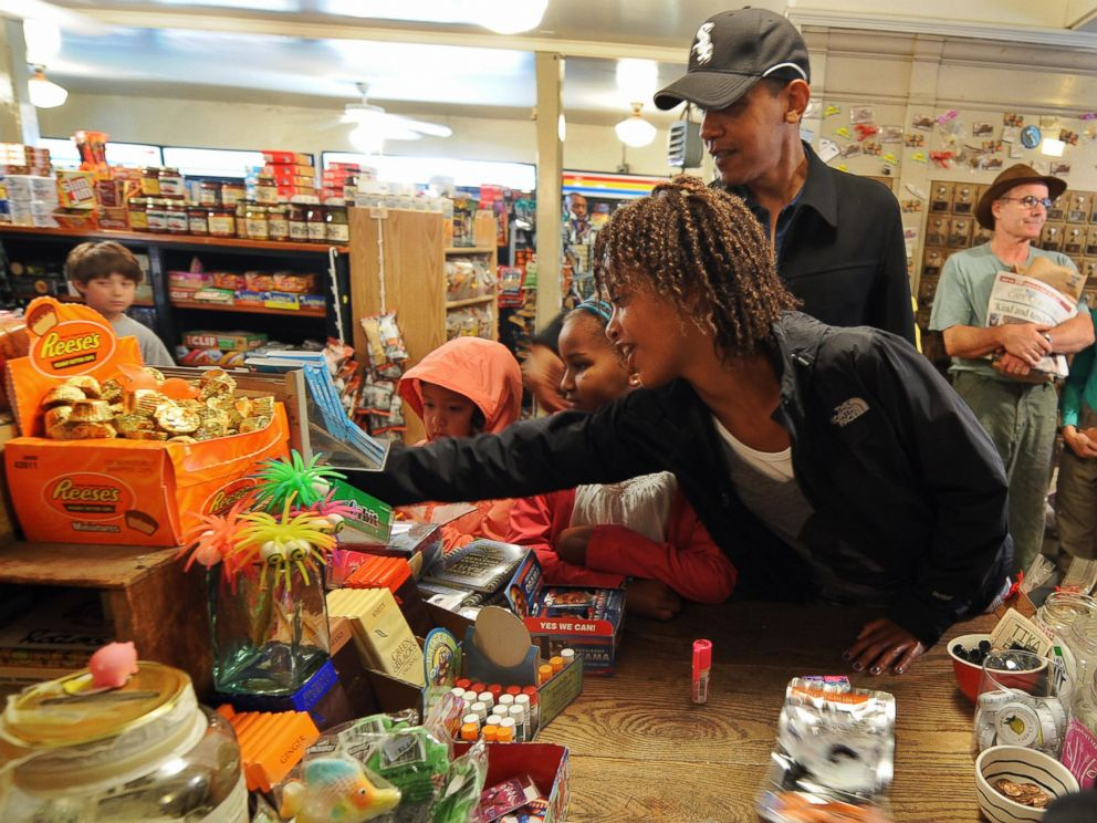 PHOTO: President Barack Obama takes his daughters Malia and Sasha to shop at Alleys General Store in West Tisbury on Marthas Vineyard, Mass. on August 30, 2009.