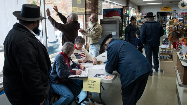 PHOTO: People arrive to vote at Beck's Mill General Store during election day on Nov. 6, 2012, in Becks Mill, Ohio.