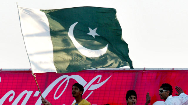 PHOTO: Supporters of the Pakistan cricket team wave a Pakistani flag as they celebrate Pakistan's victory in the last of the two Twenty20 match series between Zimbabwe and Pakistan at the Harare Sports Club, Sept. 18, 2011.