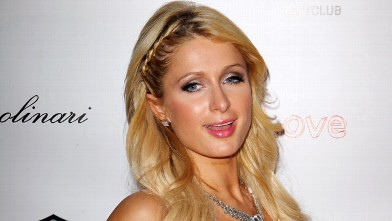 PHOTO: Paris Hilton arrives to celebrate the grand opening of 1 OAK Las Vegas and the GiveLove charity event January 27, 2012 in Las Vegas, Nevada.
