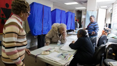 PHOTO: A voter signs in at her polling place inside the Concerned Black Men's Office on Nov. 6, 2012 in North Philadelphia, Pa.
