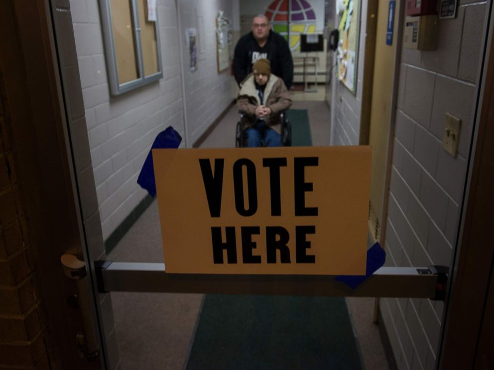 PHOTO: Voters leave a polling station during primary voting, March 15, 2016, in Canton, Ohio.