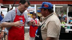 PHOTO: Wisconsin Gov. Scott Walker talks with Dana Spanky Wanken at the Iowa Pork Producers Pork Tent during the Iowa State Fair on Aug. 17, 2015 in Des Moines, Iowa.