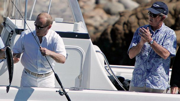 PHOTO: President George W. Bush (R) applauds as Russian President Vladimir Putin (L) catches a striped bass on July 2, 2007 while fishing in the Atlantic Ocean off of the Bush family compound in Kennebunkport, Maine.