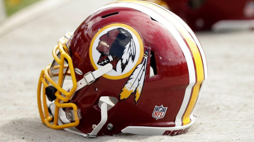 PHOTO: Washington Redskins helmets lay on the ground during their game against the Oakland Raiders on September 29, 2013 in Oakland, Calif.