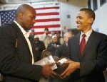 PHOTO: Presidential candidate Illinois Senator Barack Obama, hands over a statue to his assistant Reggie Love during a town hall meeting with veterans at the American GI Forum in San Antonio, Texas, March 3, 2008.