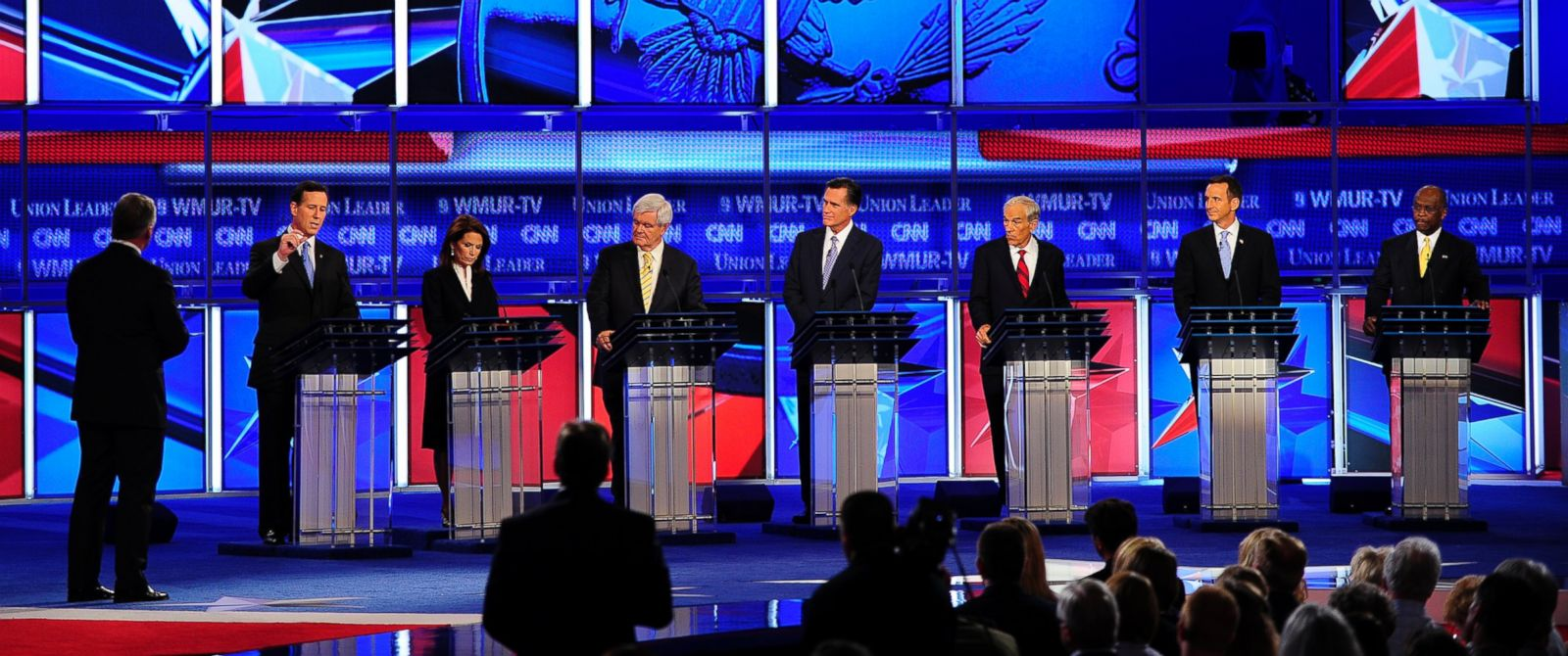 PHOTO: (L-R) Rick Santorum, Michele Bachmann, Newt Gingrich, Mitt Romney, Ron Paul, Tim Pawlenty, Herman Cain address the first 2012 Republican presidential candidates debate in Manchester, New Hampshire, June 13, 2011.