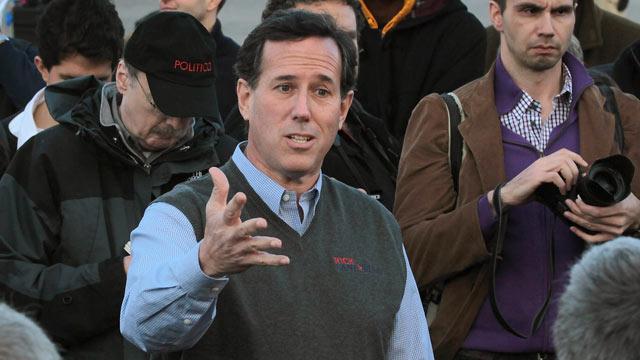 PHOTO: Republican presidential candidate former U.S. Senator Rick Santorum (R-PA) speaks outside the Pella Public Library during a campaign stop, Pella, Iowa, Dec. 31, 2011.