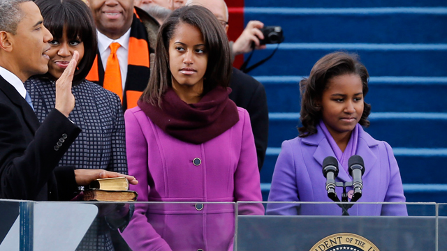 PHOTO: President Barack Obama is sworn in as daughters Malia Obama and Sasha Obama look on during the public ceremonial inauguration on the West Front of the U.S. Capitol Jan. 21, 2013 in Washington, DC.