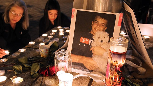 PHOTO: A photograph sits on a memorial for Scott Olsen.