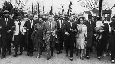 PHOTO: American civil rights campaigner Martin Luther King (1929  - 1968) and his wife Coretta Scott King lead a black voting rights third march from Selma, Ala., to the state capital in Montgomery, March 30, 1965.