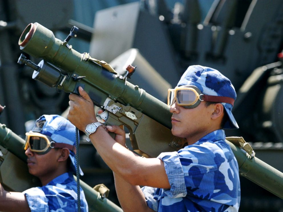 PHOTO: Nicaraguan soldiers carry SA-7 anti-aircraft missiles during a parade in Managua in 2003.