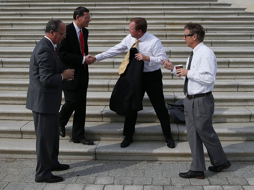PHOTO: Rep. Rep. Mick Mulvaney (R-SC), Sen. John Barrasso (R-KY), Rep. Brett Guthrie (R-KY) and Sen. Rand Paul (R-KY) take a coffee break on the Senate steps at the U.S. Capitol October 3, 2013 in Washington, DC.