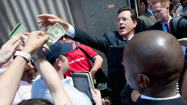 PHOTO: Stephen Colbert began accepting donations for $50 or less on the sidewalk outside the building.