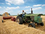 PHOTO: A farmer drives a tractor as farmhands stack straw bales in Kirkland, Ill., in this July 14, 2011 photo.