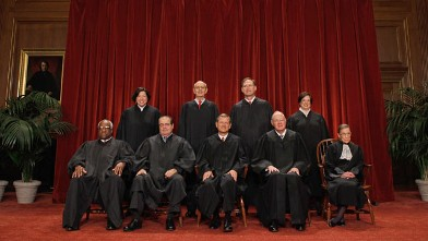 PHOTO: U.S. Supreme Court members (first row L-R) Clarence Thomas, Antonin Scalia, Chief Justice John Roberts,  Anthony Kennedy,  Ruth Bader Ginsburg, (back row L-R) Sonia Sotomayor, Stephen Breyer, Samuel Alito, Elena Kagan pose for a photo, Oct. 8, 2010