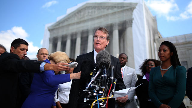 PHOTO: Bill Powers (C), President of the University of Texas at Austin, speaks to the media after attending arguments on whether the universitys consideration of race in admissions is constitutional at the U.S. Supreme Court Supreme, on October 10, 2012