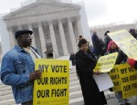 PHOTO: Activists distribute pro-voting rights placards outside of the US Supreme Court, Feb. 27, 2013 in Washington.