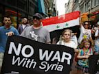 PHOTO: Matthew Krawitz of Swampscott holds a sign reading No War with Syria, along with his daughters Margaret, 11, and Samara, 7, during a rally against the United States entering into war with Syria in Boston, Aug. 31, 2013.