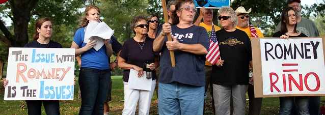PHOTO: Members of the New Hampshire Tea Party protest against former Massachusetts governor and republican candidate for president Mitt Romney before the start of a Tea Party Express rally, Sept. 4, 2011 in Concord, New Hampshire.