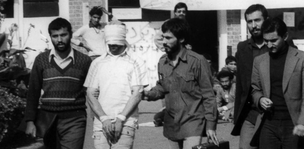 PHOTO: A blindfolded American hostage with his hands tied is walked through the compound of the U.S. Embassy in Tehran on Nov. 11, 1979 in Iran.