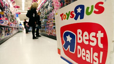 PHOTO: Customers browse toys inside a Toys &quot;R&quot; Us Inc. store in London on Dec. 20, 2011.
