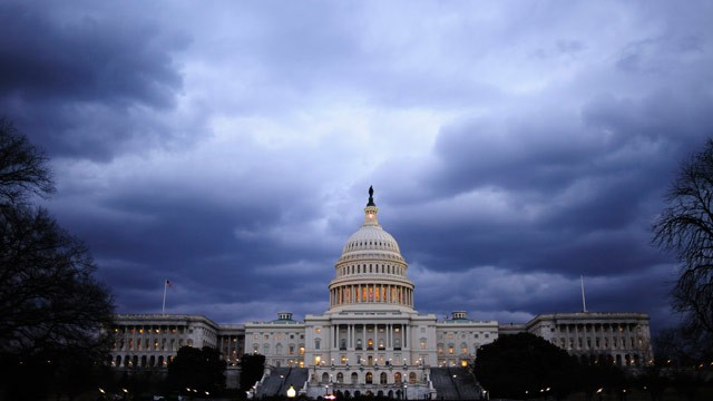 PHOTO: Dark clouds hang over the U.S. Capitol in Washington, D.C., U.S., on Thursday, Feb. 28, 2013.
