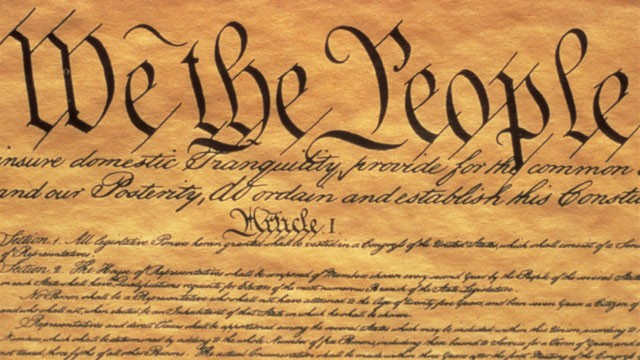 PHOTO: The Preamble to the US Constitution starts with the phrase &quot;We The People&quot; and shows only some of the writing from the upper left hand corner of the document of the Constitution.