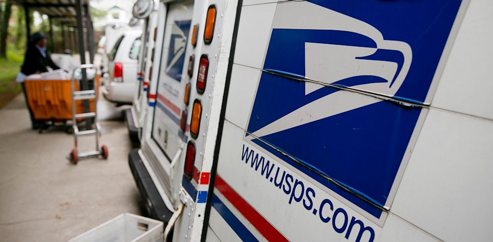 PHOTO: U.S. Postal Service delivery trucks sit at the Brookland Post Office in Washington, D.C., May 9, 2013.