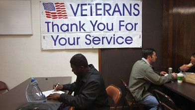 PHOTO: Unemployed U.S. Air Force veteran Tracy McConner, 45, registers at the Military and Veterans Employment Expo on May 24, 2011 in Golden, Colorado.