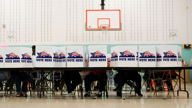 PHOTO: Voters cast their ballots in the general election November 6, 2012 at Earl Nance Sr. Elementary School in St. Louis, Missouri.