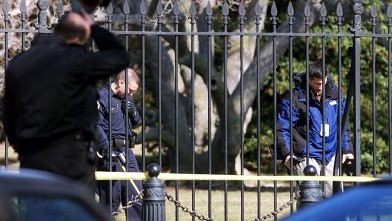 PHOTO: Uniformed Secret Service agents scour the White House grounds with metal detectors after alleged gunman Robert Pickett of Evansville, Indiana was shot in the leg by a Secret Service agent outside of the White House, Feb. 7, 2001.